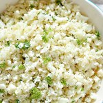 close up of cauliflower rice in bowl with parsley