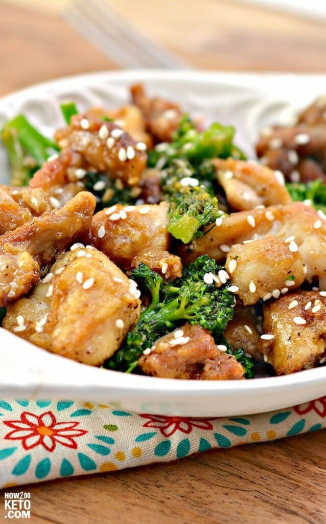 chicken in brown sauce with sesame seeds and broccoli