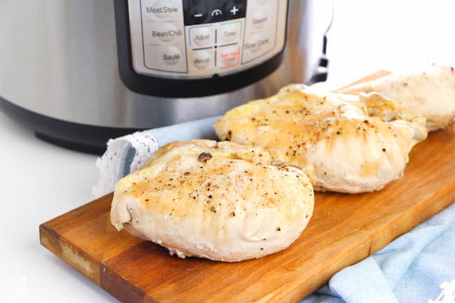 ThisInstant Pot Chicken Breastis an easy and healthy staple perfect for meal planning! Ready in about 20 minutes and only 1 gram carbs per serving!