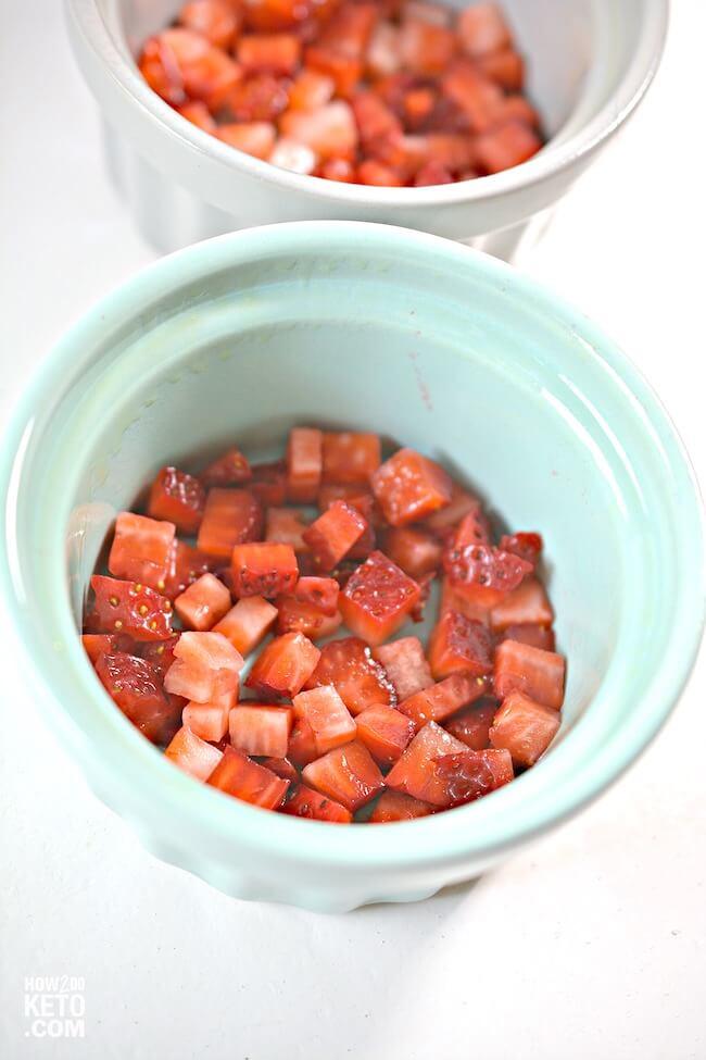 chopped strawberries in a mug