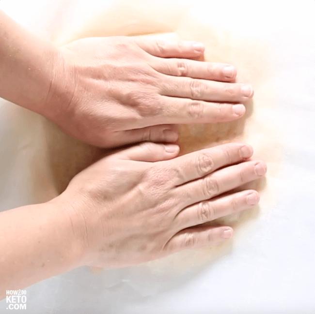 pressing cauliflower pizza dough into round shape