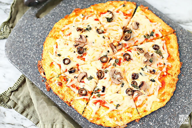 Yes, you can still have pizza on a low carb diet! This cheesyKeto Cauliflower Pizza Crustmight just be better than the real thing!