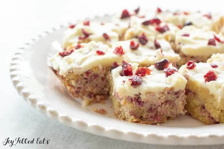 keto cranberry bliss bars on white plate