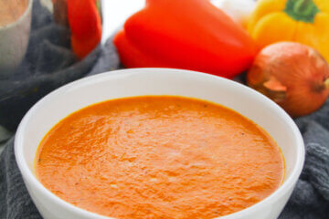 bowl of roasted red pepper soup with veggies