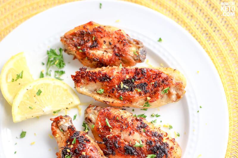 crispy lemon pepper wings with lemon wedges