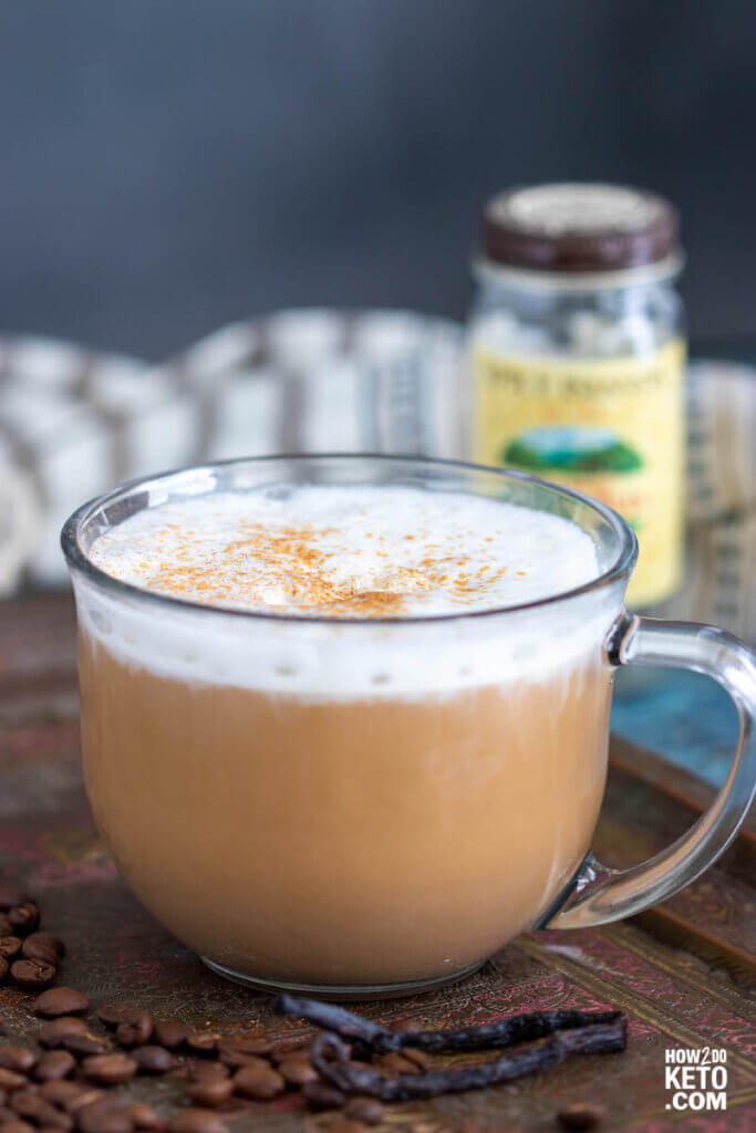 frothy low carb latte in clear mug