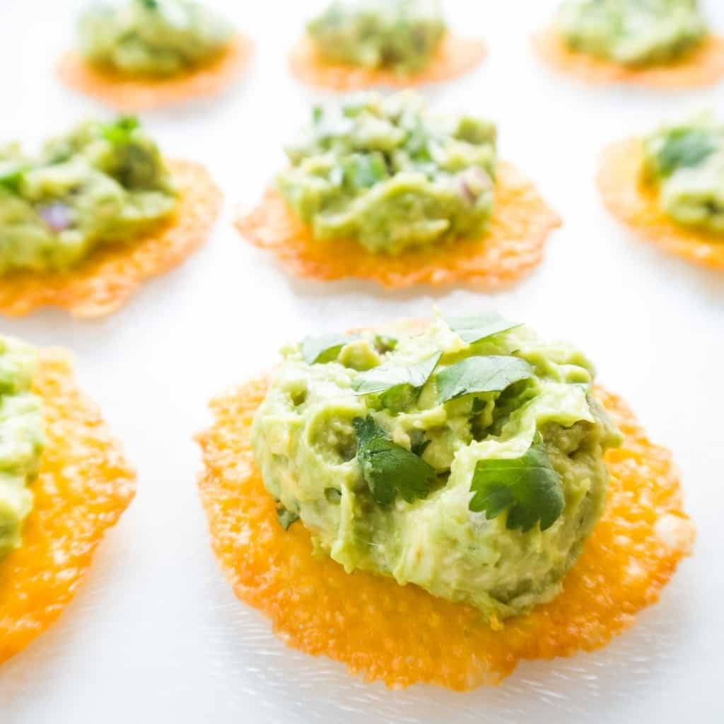 cheese chips with guacamole on top
