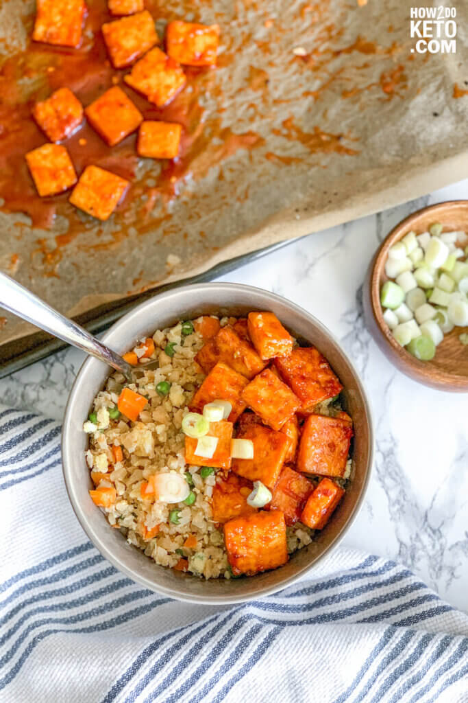 This low carb and vegetarian-friendly Keto Firecracker Tofu & Fried Cauliflower Rice is the perfect way to spice up your keto life!