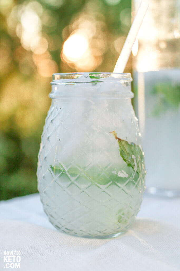 coconut mojito drink in a clear mason jar, garnished with mint