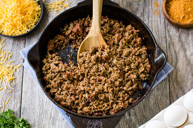 cooking ground beef in an iron skillet