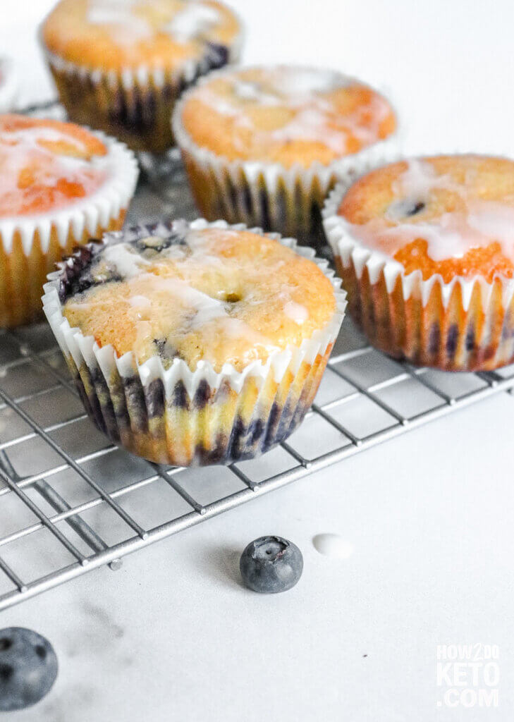 close up of a low carb blueberry muffin with lemon glaze