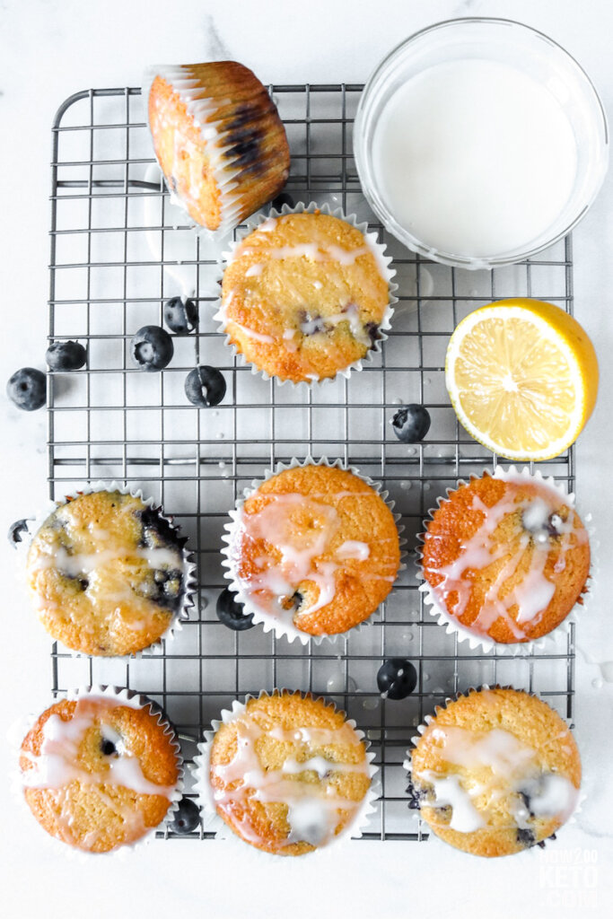 keto lemon blueberry muffins with fresh blueberries and lemon on wire rack