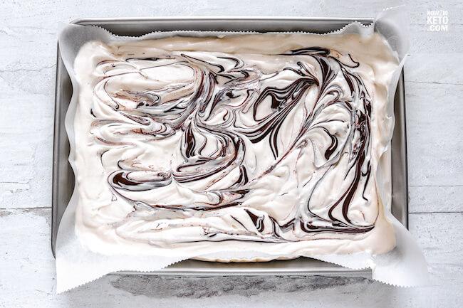 dark chocolate swirled into cheesecake bark mixture