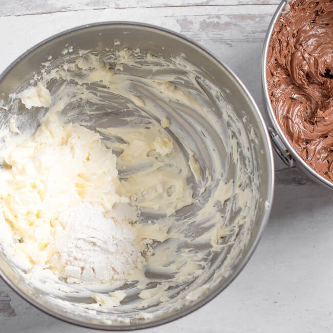 mixing bowl of cream cheese and another bowl of chocolate cream cheese