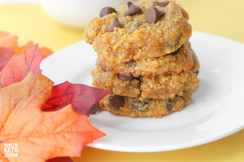 low carb pumpkin chocolate cookies on plate with fall leaves