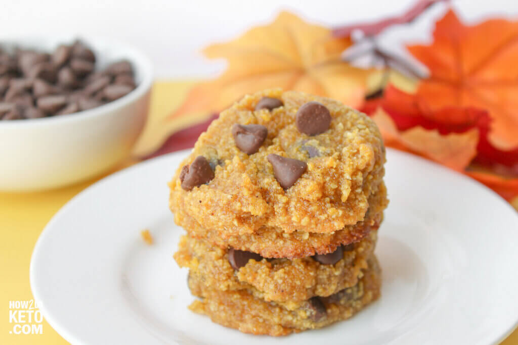keto pumpkin chocolate chip cookies on plate with fall background