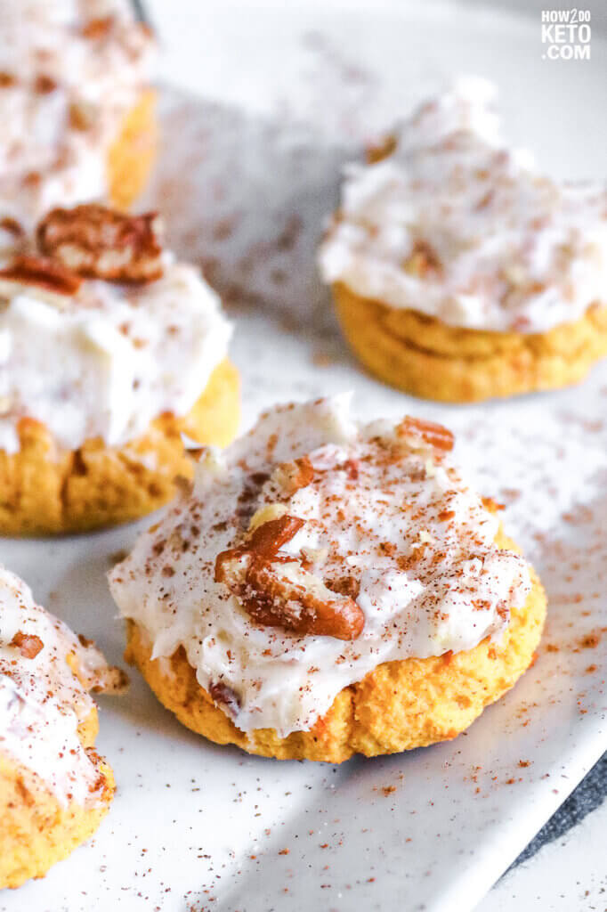 keto pumpkin cookies topped with cream cheese icing