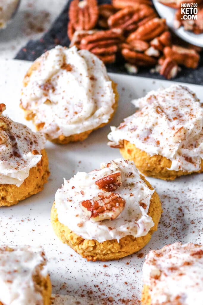 close up of fluffy low carb pumpkin cookies with frosting