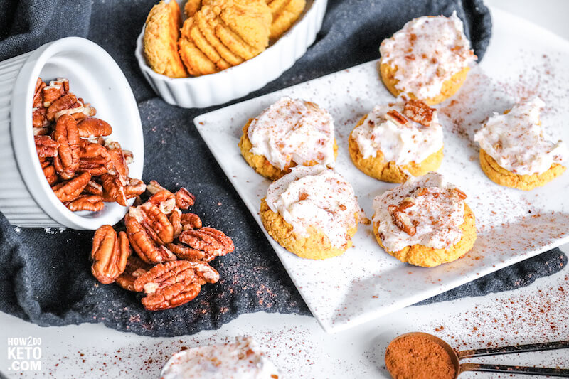 plate of pumpkin cookies with a bowl of pecans