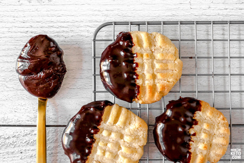 chocolate dipped butter cookies with spoonful of chocolate