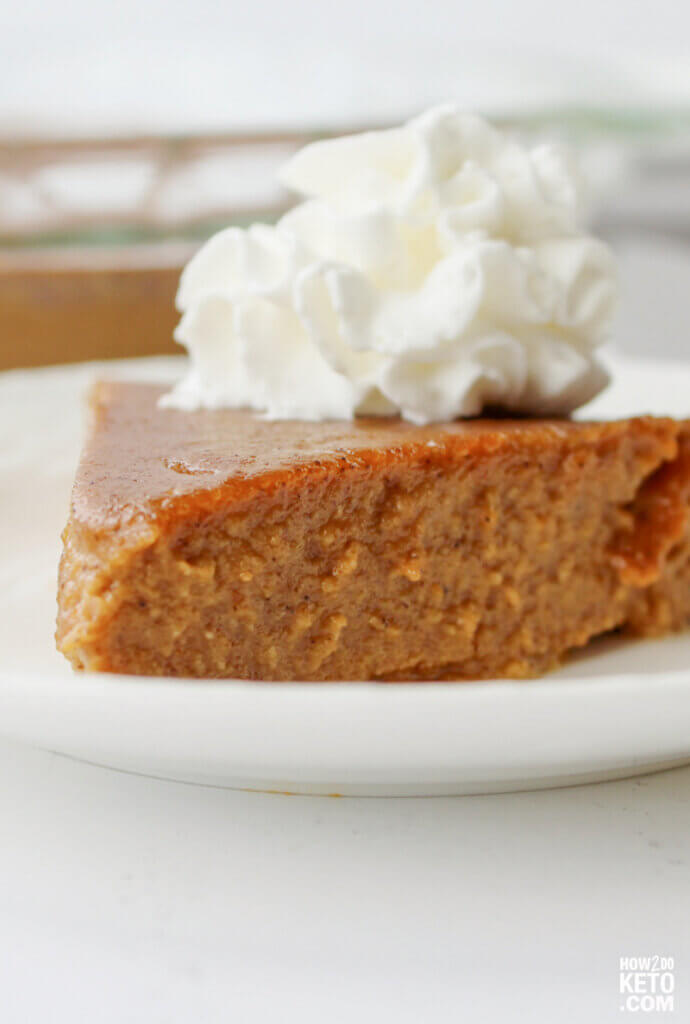 slice of crustless keto pumpkin pie with whipped cream