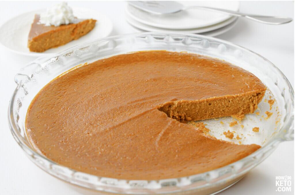 crustless keto pumpkin pie with slice missing