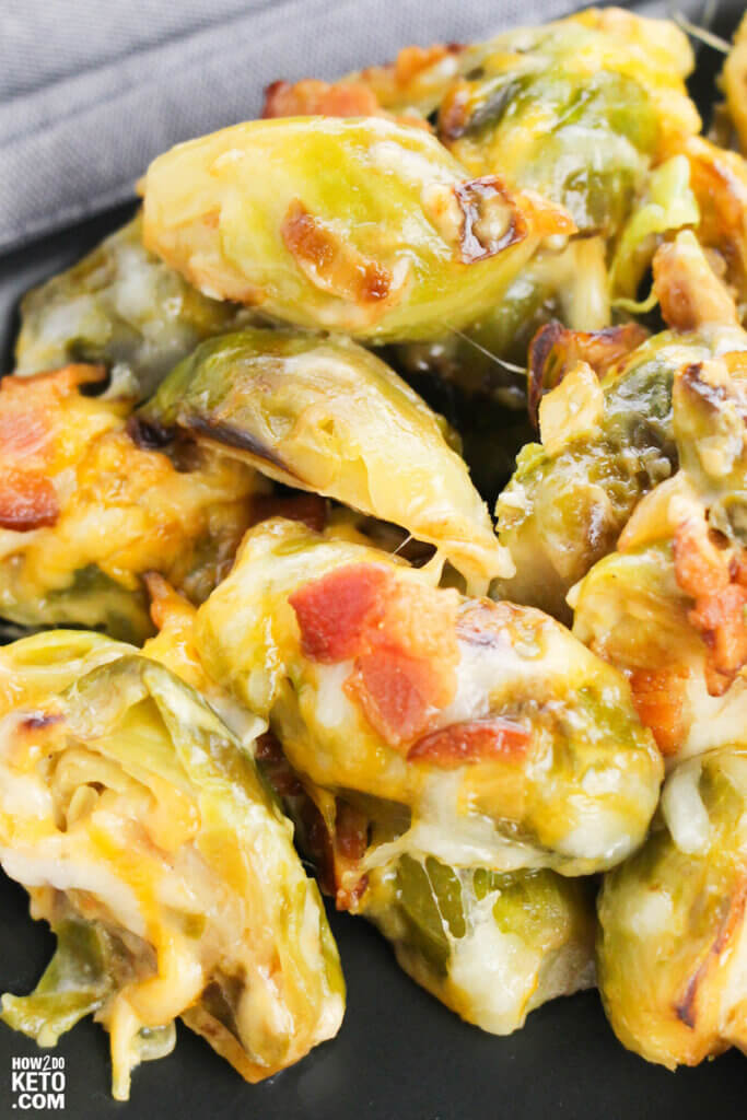 baked brussel sprouts coated in cheese and bacon
