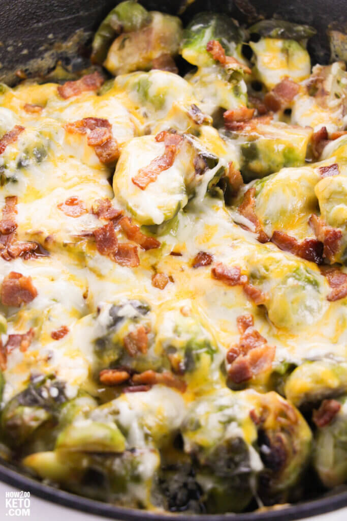 brussel sprouts coated in melted cheese and bacon