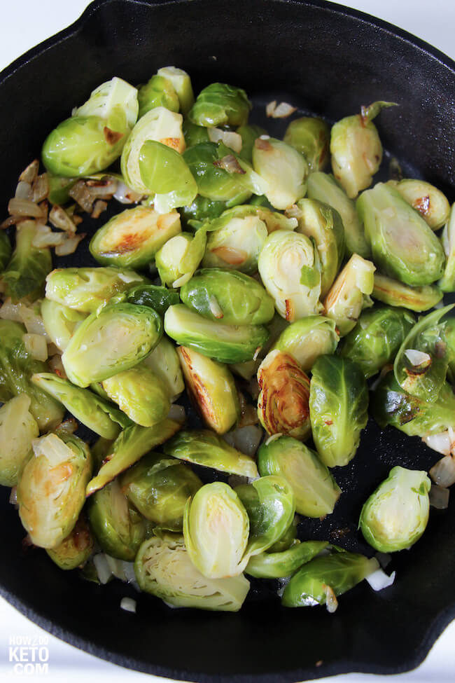 sautéed onions and brussel sprouts in cast iron skillet