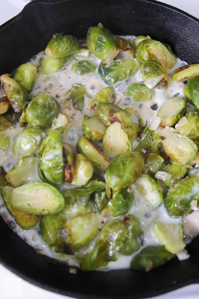 brussel sprouts cooking in milk in skillet