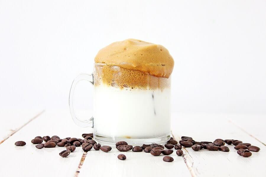 glass of milk with coffee foam
