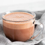glass mug of keto hot cocoa with a layer of foam