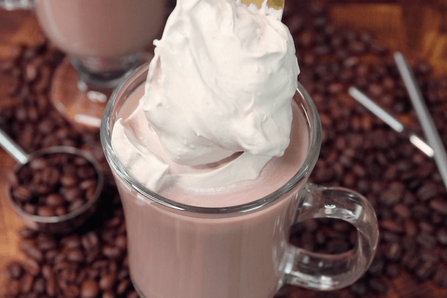 adding whipped cream to keto dalgona coffee