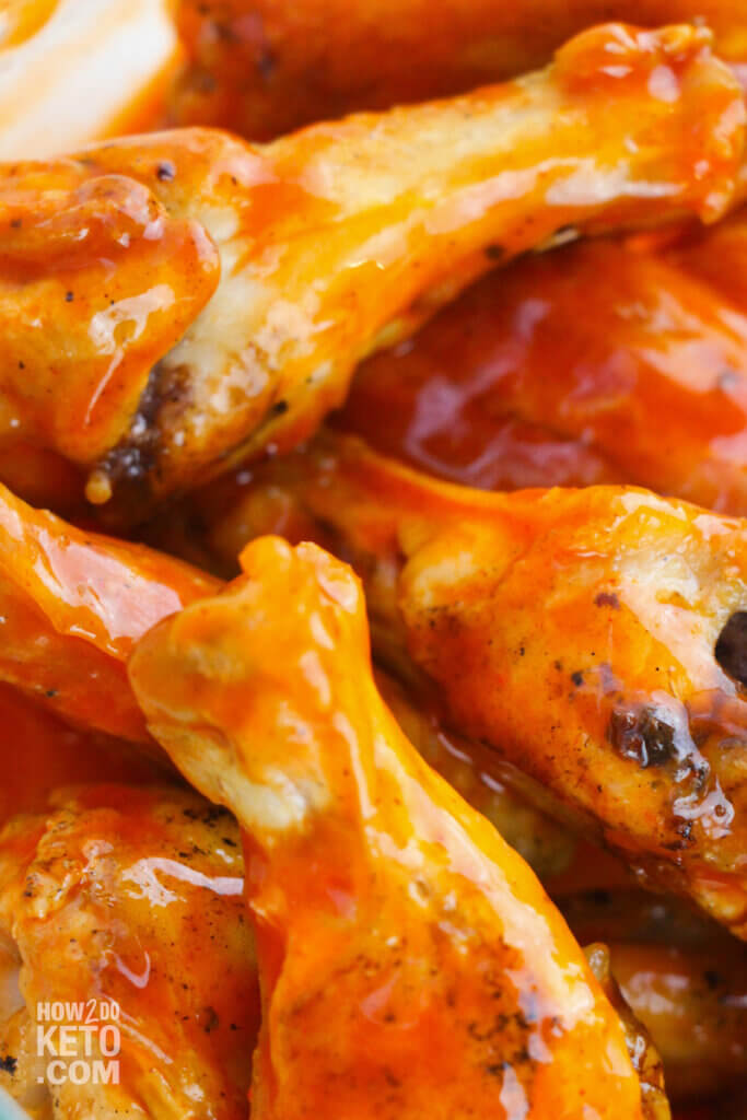 close up of baked buffalo wings