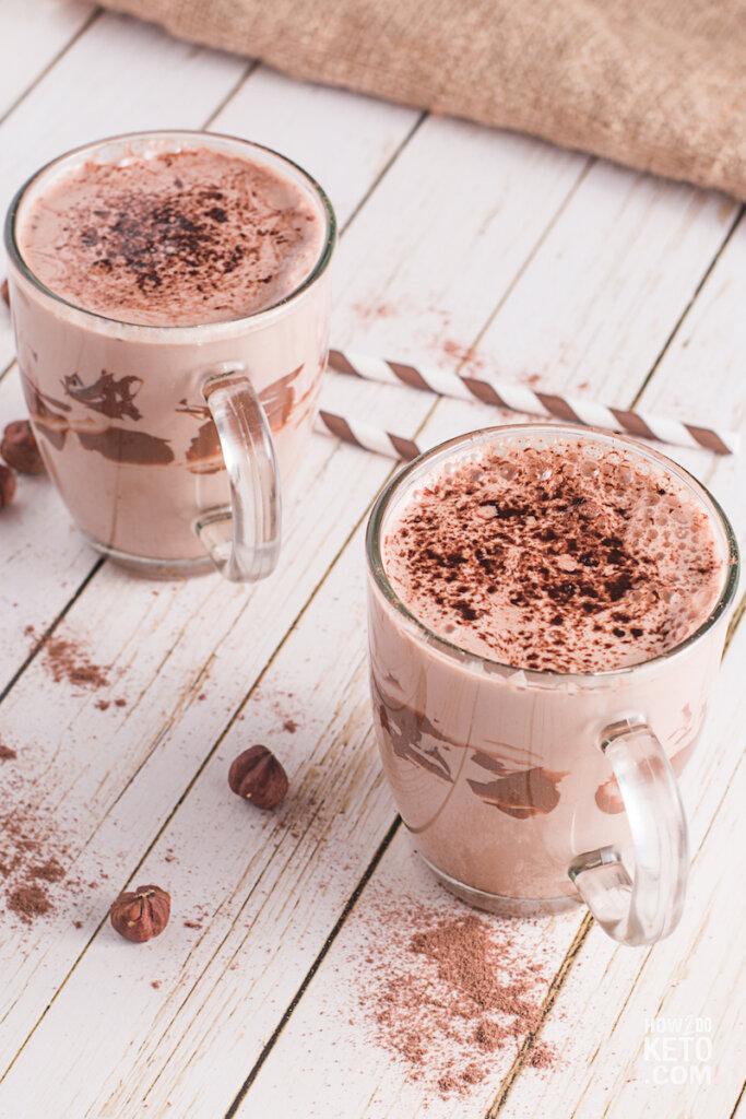 two mugs of chocolate milkshake with straws