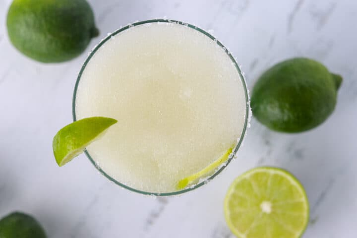 top down shot of a Margarita with limes