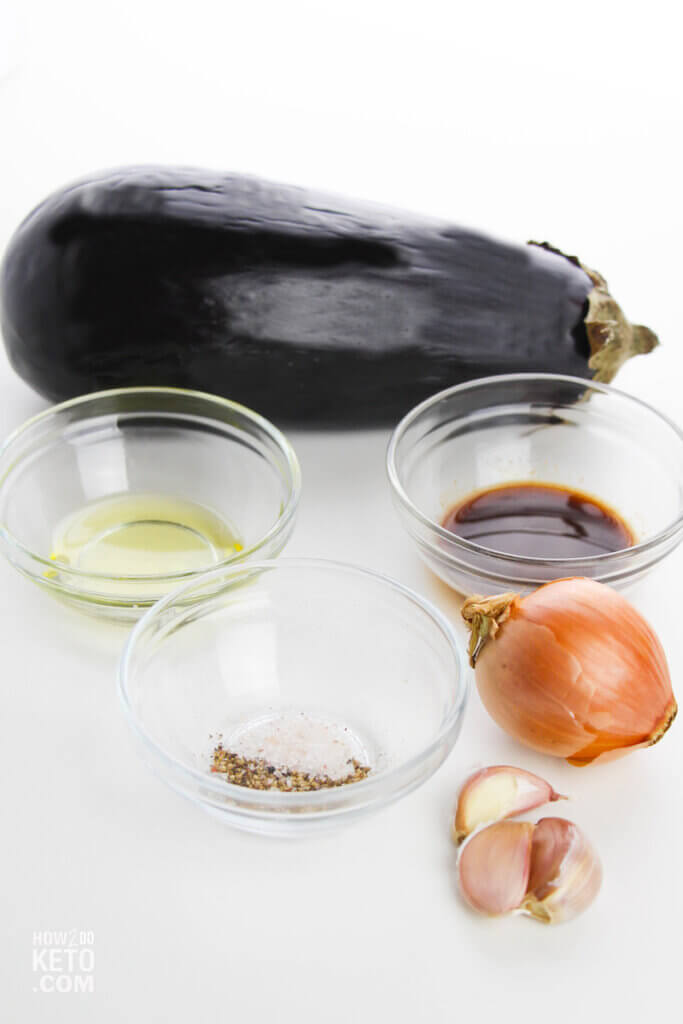 whole eggplant with bowls of olive oil and spices