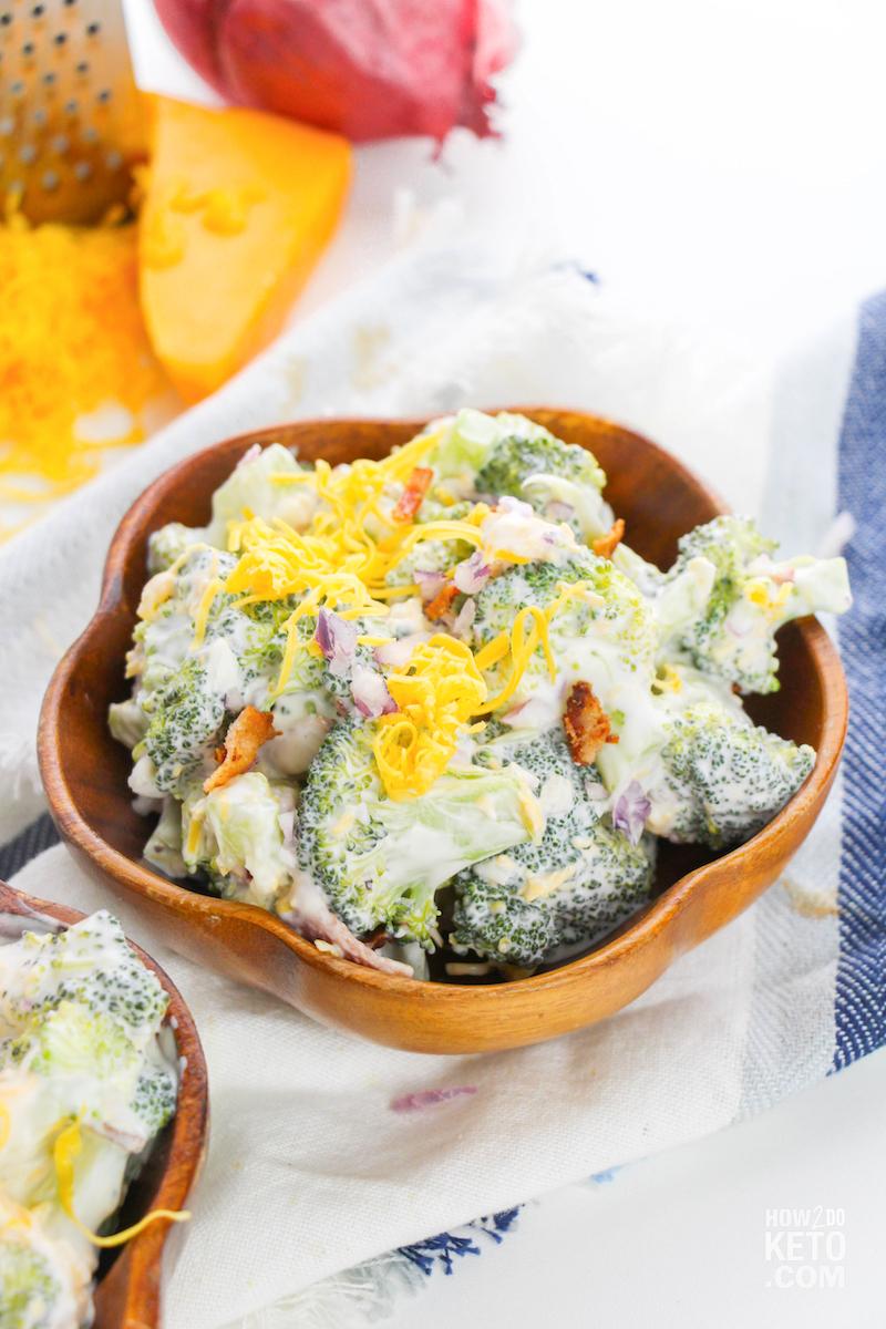 fresh keto broccoli salad in wooden bowl