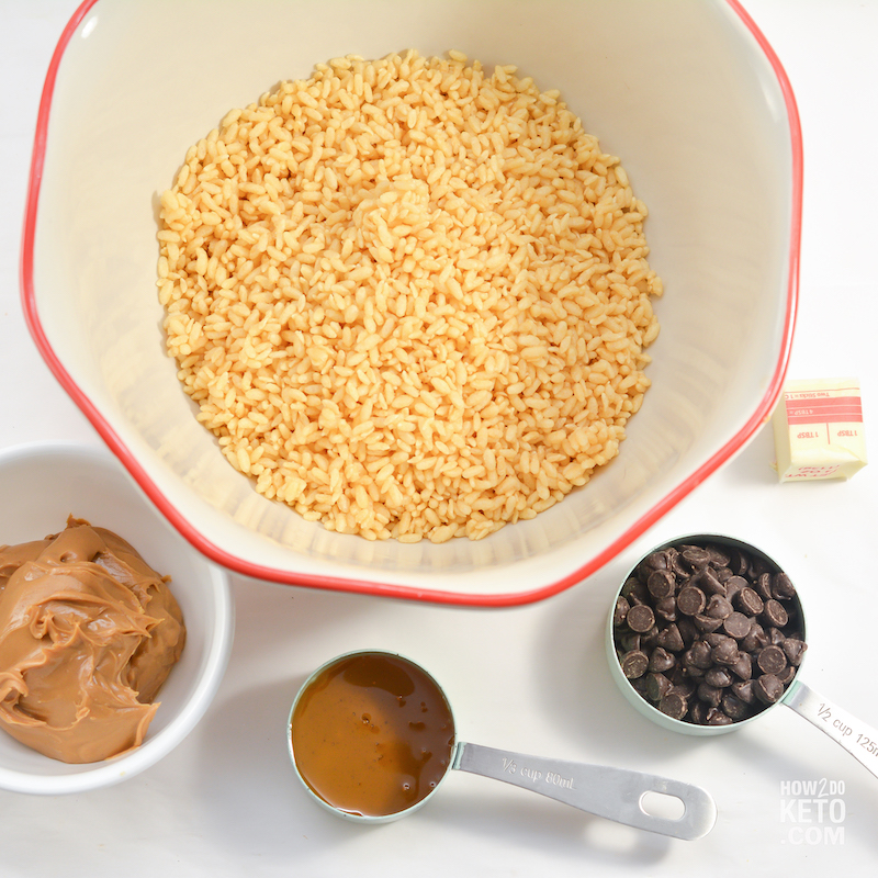 rice krispies in bowl, chocolate chips, and peanut butter