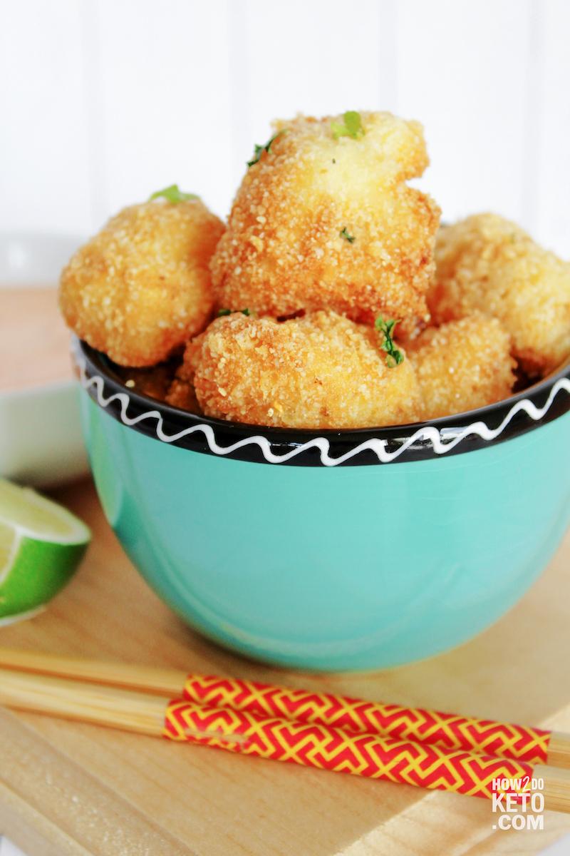 Finished Keto Bang Bang Cauliflower in blue bowl with chopsticks