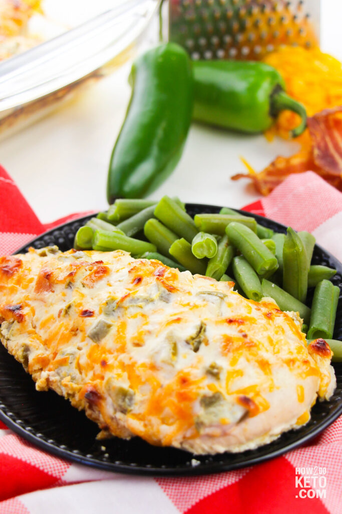 Low Carb Jalapeño Popper Chicken on a plate with green beans