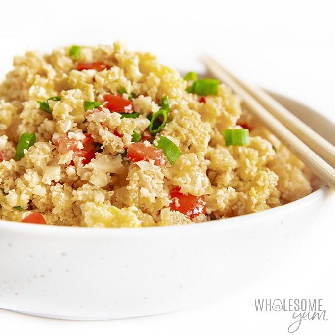 keto cauliflower fried rice with chopsticks