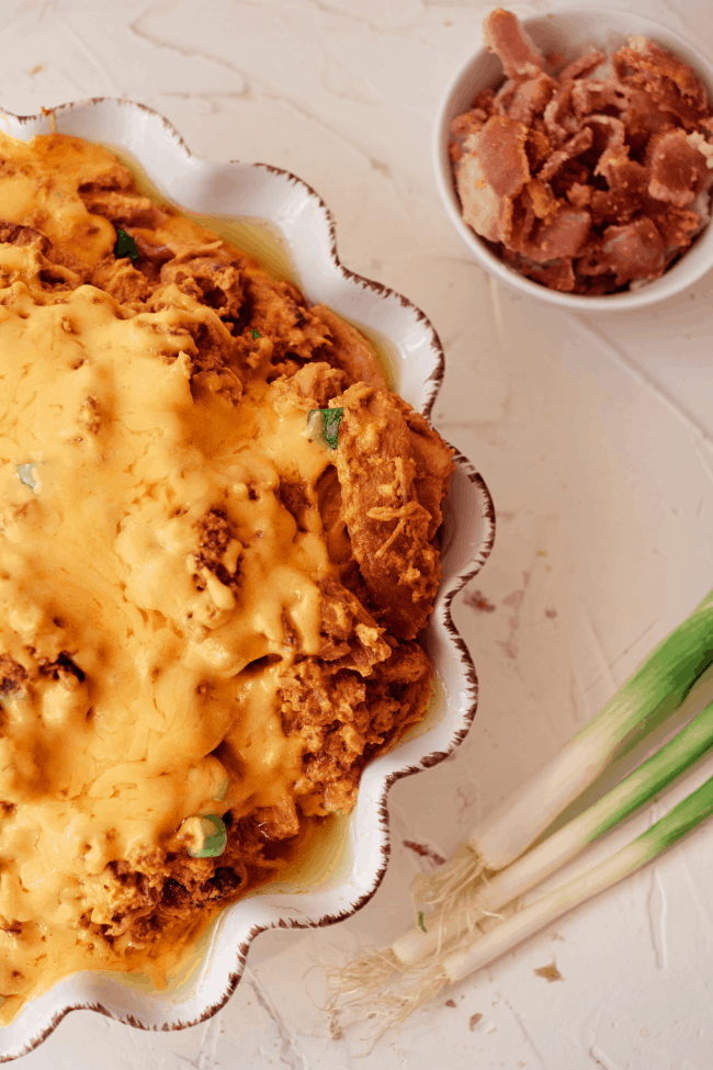 chicken topped with cheese sauce