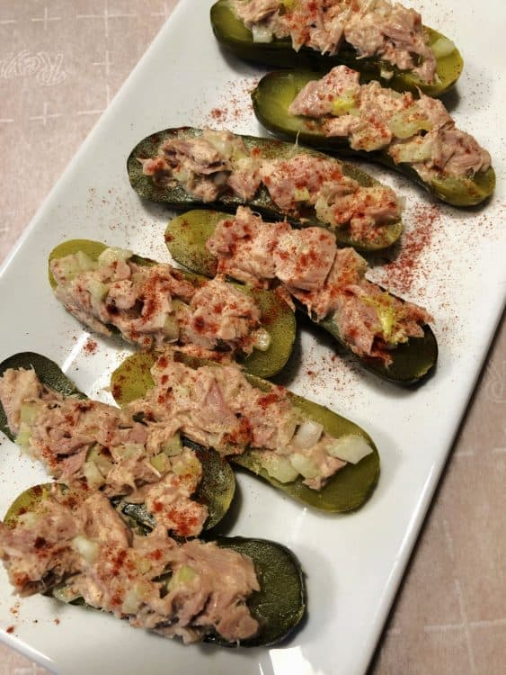 dill pickle slices topped with tuna salad