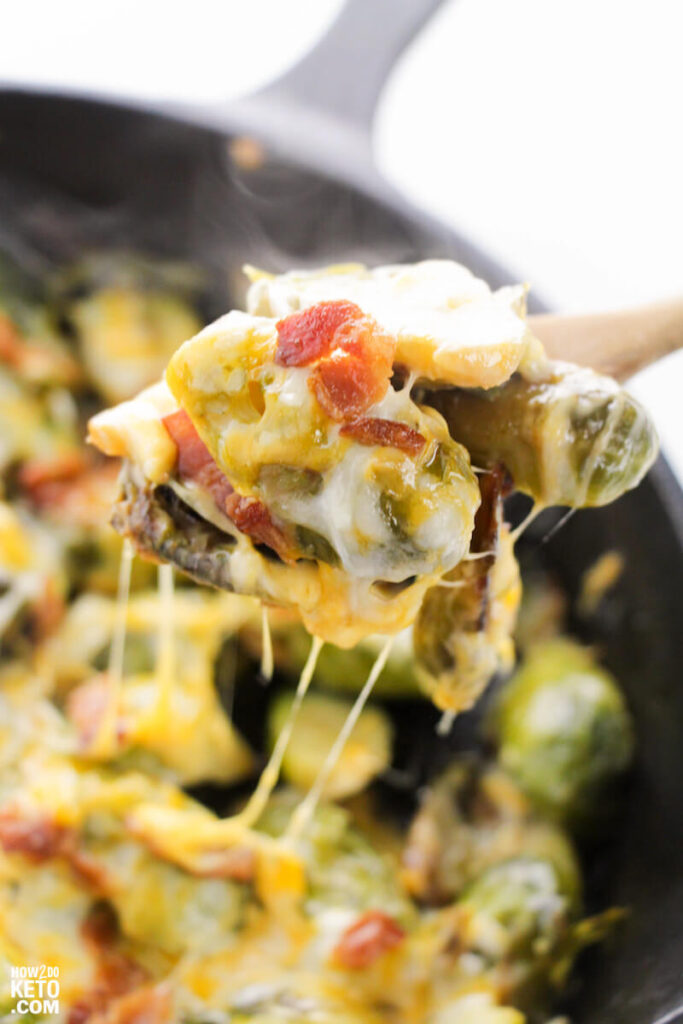 cheesy brussel sprouts and bacon in skillet