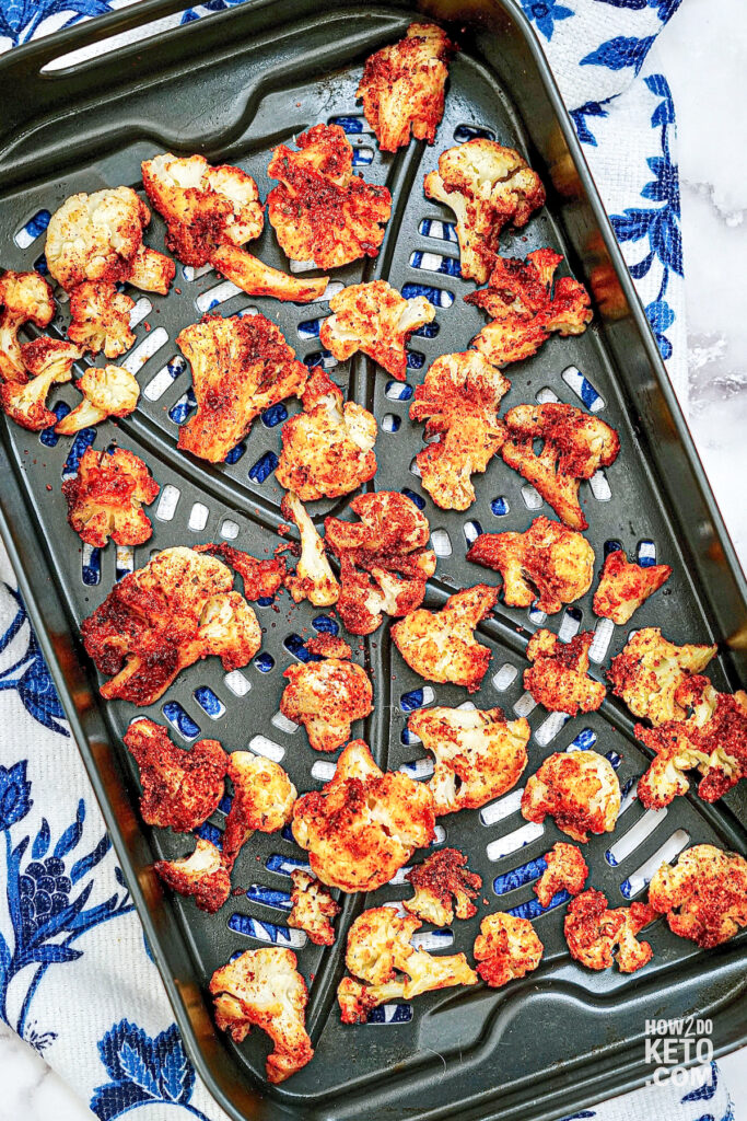 buffalo seasoned cauliflower on baking sheet